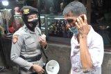 Polisi dikerahkan di seluruh Pasar Palembang awasi protokol kesehatan