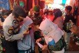 Tim Satgas Lembah Gumanti bersama Puskesmas Alahan panjang sosialisasikan Perbup No 44 tahun 2020