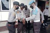 Polres Merauke bagikan 150 masker ke personel cegah corona