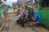 Satgas TMMD 109 gotong royong bersama masyarakat bangun musala