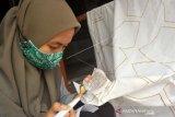 Pembuatan Masker Batik Ikon Minang