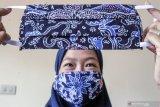 Masyarakat diminta untuk menggunakan masker label SNI atau kain dua lapis