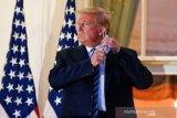 Cuitan Trump dirinya kebal corona, ditandai Twitter