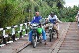 Artikel - Membangun Jembatan Masa Depan Desa Terisolasi Melalui TMMD