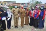 FKPLKB inhu peduli masyarakat dengan bagikan masker gratis