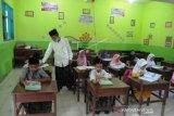 Sambut Hari Santri Gunakan Busana Muslim
