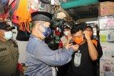 Sosialisasi Protokol Kesehatan, Pjs Gubernur Bagikan Masker