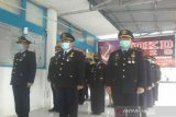 Imigrasi Palu  ikut upacara virtual HDKD 2020