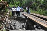 Bupati Barut  instruksikan perbaikan  jalan rusak dan longsor