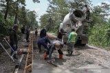 Jalur evakuasi Merapi dengan cor blok berkualitas bagus