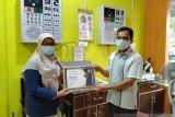 BPJS Kesehatan Padang  apresiasi Optik R3 salurkan CSR untuk pembayaran iuran JKN-KIS