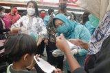 TP-PKK Sulawesi Utara bagikan masker kepada warga untuk cegah COVID-19