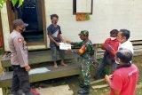 Babinsa  kawal pendistribusian BLT DD di Murung Raya