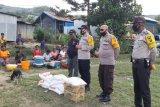 Kapolres Tolikara berikan bantuan korban kebakaran