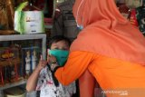 Satgas BUMN Provinsi Lampung bagikan 1.000 masker di Bambu Kuning