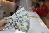 Dolar tahan kenaikan karena investor hati-hati virus corona