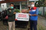 Pertamina Cilacap kembali serahkan bantuan logistik COVID-19