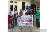 Perantau Riau dan Pajero Sport Family bantu korban banjir di Kota Solok