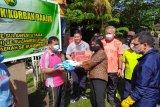 Kajati Sulut serahkan bantuan pegawai dan warga korban banjir