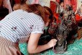 Sambut Tahun Baru Imlek, warga Tionghoa Banyumas bersihkan rupang