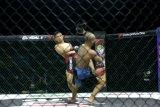 Billy Pasulatan pertahankan gelar kelas Strawweight  One Pride MMA