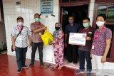 Alfamart salurkan bantuan korban banjir di Manado