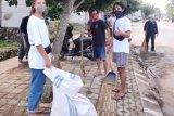 Dispar NTB menggelar bersih-bersih di Mandalika