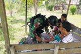 Satgas Yonif 100/PS beri layanan kesehatan bagi warga di perbatasan