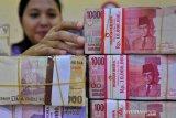 Rupiah melemah seiring  naiknya imbal hasil obligasi AS