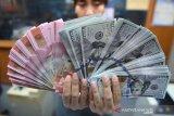 Rupiah menguat seiring masih tertekannya imbal  hasil obligasi AS