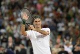 Ritual Federer usai kalahkan Evans