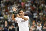 Federer penuh semangat lalui babak pertama French Open