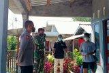 Bhabinkamtibmas Desa Batu putih laksanakan pendampingan monitoring pasien Isolasi mandiri