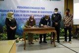 Pemkab Sleman menandatangani perjanjian pembayaran e-retribusi pasar