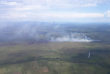 Foto udara lahan terbakar. Pantauan melalui udara menunjukkan beberapa titik api di lahan-lahan yang terbakar di Kendawangan dan Ketapang, Kabupaten Ketapang, yang diambil Satgas Udara BPBD Kalbar pada Senin (22/3).
