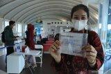 Uji coba test covid genos C-19 di Bandara SMB II Palembang
