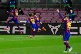Barcelona kini terpaut satu poin dari Atletico