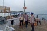 Sukseskan Kampung Sehat, Sat Polair bagikan masker