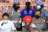 Polisi tangkap seorang perempuan pengirim satai beracun yang menewaskan anak pengemudi ojek