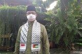 Anies Baswedan shalat Id gunakan sorban berbendera Indonesia dan Palestina