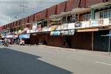 Sebagian besar pertokoan di Pasar Lubuk Sikaping Pasaman tutup hari pertama Lebaran