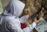 Kisah dari Sangihe: Setahun belajar online