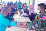 Satgas TNI Yonif 315/Grd bersama Dinkes Mappi vaksinasi 776 warga