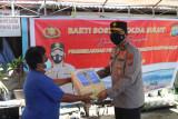 Polda Sulut salurkan 1.100 paket sembako bagi warga terdampak pandemi
