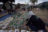 Dompet Dhuafa bersama Bango bagikan daging kurban bersama kecap dan Bumbu Racik Nusantara