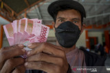 Penyaluran Bantuan Sosial Tunai di Palu