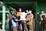 Kulon Progo menyalurkan bantuan sosial kepada keluarga penerima manfaat