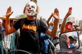 Inggris: prinsip demokrasi, HAM selesaikan krisis politik di Tunisia