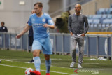 Pep Guardiola berharap pemain City bisa langsung berlatih tanpa karantina