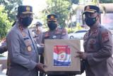 Kapolda Sulut serahkan bantuan obat dan APD kepada personel